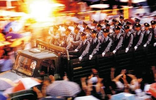 People's Liberation Army arrive into Hong Kong in 1997 (via english.cntv.cn)